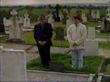 Kevin Ludlow, at left in this photograph, a brother of the innocent victim, is pictured  at Seamus' grave at Ravensdale, with his nephew Jimmy Sharkey.