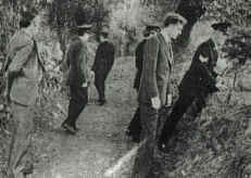 Gardai searching the lane where Seamus Ludlow's body was found. In civilian clothes at right is John Courtney, one of two detectives who received a file from the RUC in 1979, naming four loyalist suspects for this killing.
